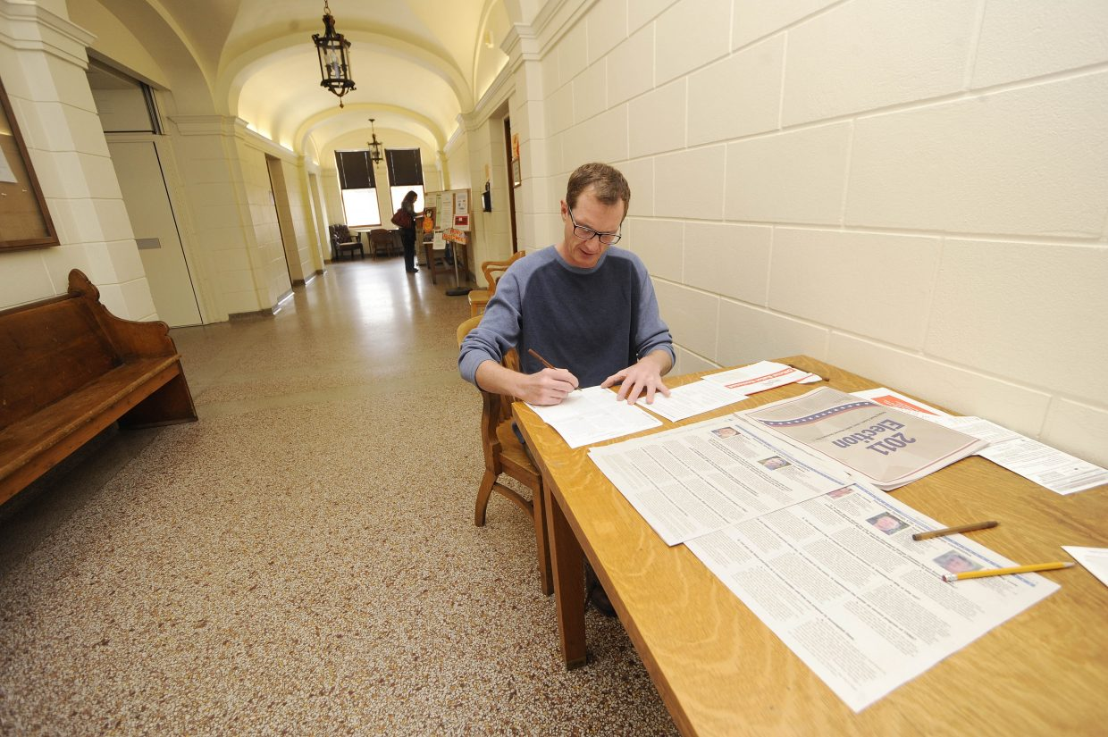 Steamboat Springs resident Dan Foote fills out his ballot Tuesday at the Routt County Courthouse.