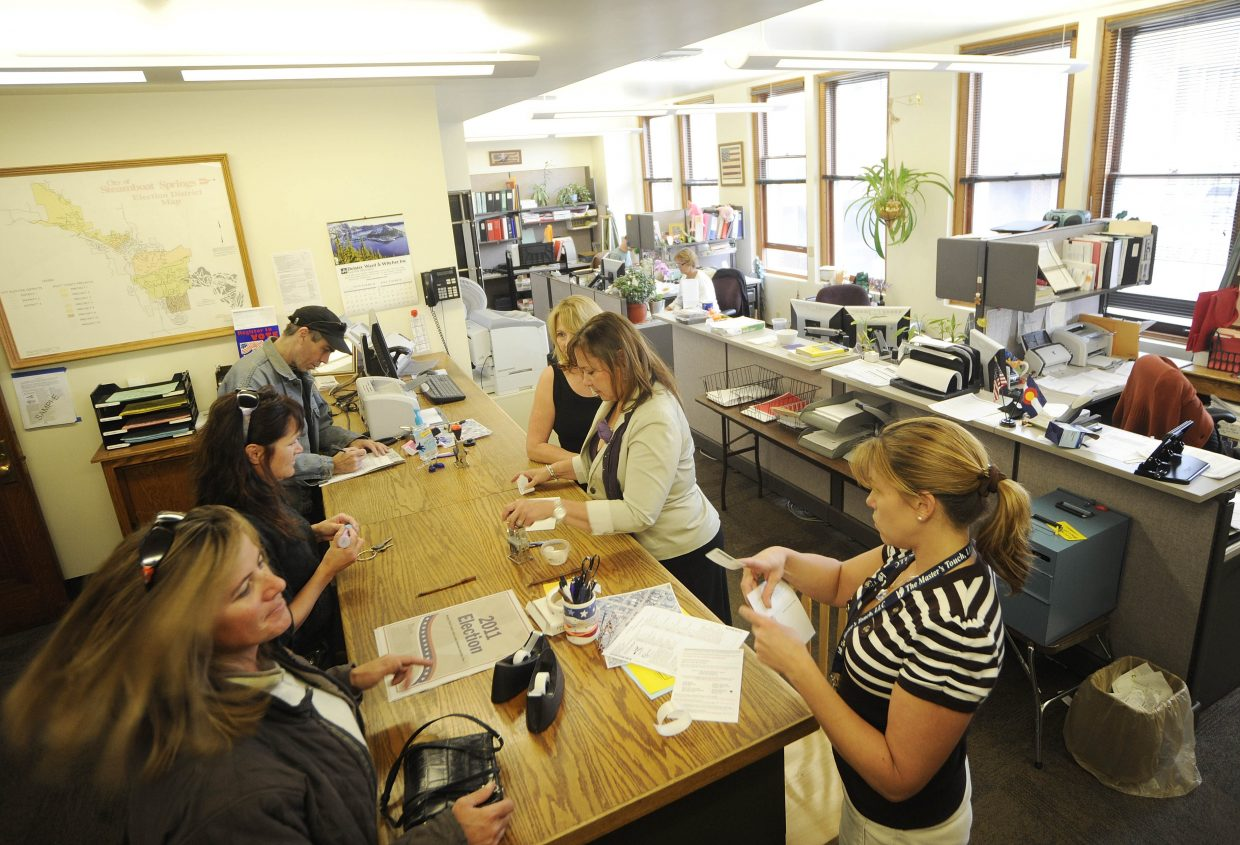 Election officials help voters Tuesday at the Routt County Courthouse. With an active voter turnout of about 67 percent, this year's election could be a county record.