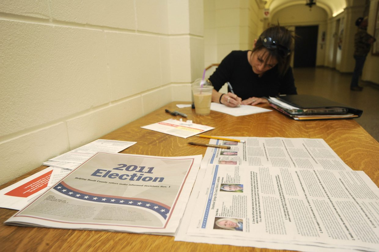 Steamboat Springs resident Tonya Sloan fills out her ballot Tuesday at the Routt County Courthouse.