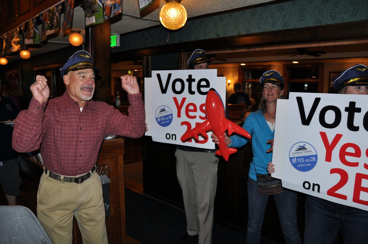 Yes 2 Air Campaign Manager Bill Stuart leads Referendum 2B supporters in a celebratory dance Tuesday night at Old Town Pub. The referendum was approved by voters.