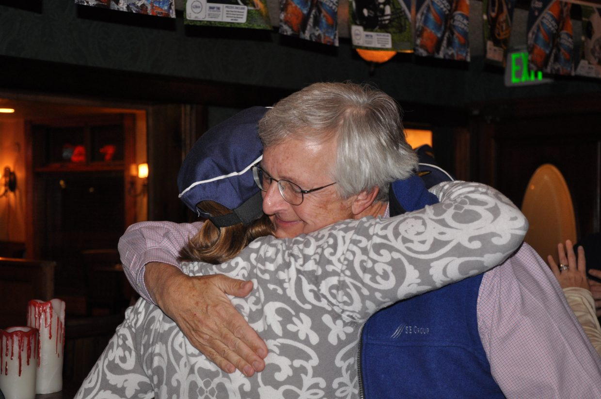 Steamboat Ski & Resort Corp. President Chris Diamond hugs Stamboat Chamber Resort Association Finance Director Marion Taylor on Tuesday night after learning that voters had approved Referendum 2B.