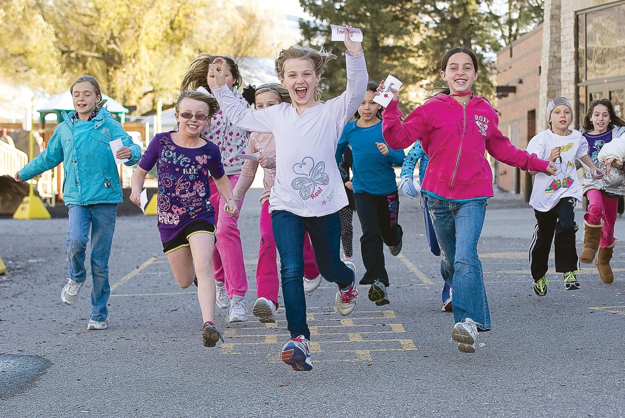 Soda Creek Elementary School student Emory Pittman leads a group of young runners during a Girls on the Run training session at the downtown Steamboat Springs elementary school Wednesday afternoon. The 10-week after-school program, which seeks to empower young girls through training and life lessons, will come to a conclusion Saturday with a 5-kilometer run.