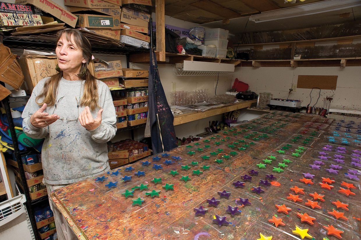 LuAnn Foty explains how she started recycling crayons and why she feels it is important inside her workshop in Milner as a batch of recently recycled crayons takes shape.