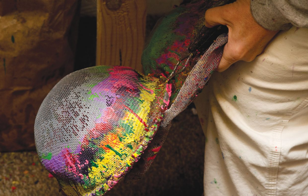 The colors of crayons leave a mark on strainers used to separate the labeling from crayons in the recycling process.