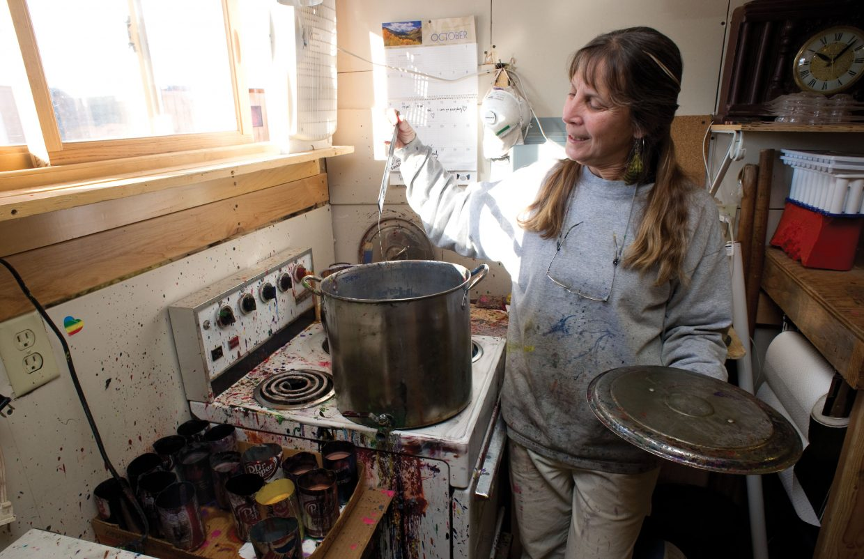 LuAnn Foty uses a stove to melt used crayons as part of the recycling process.
