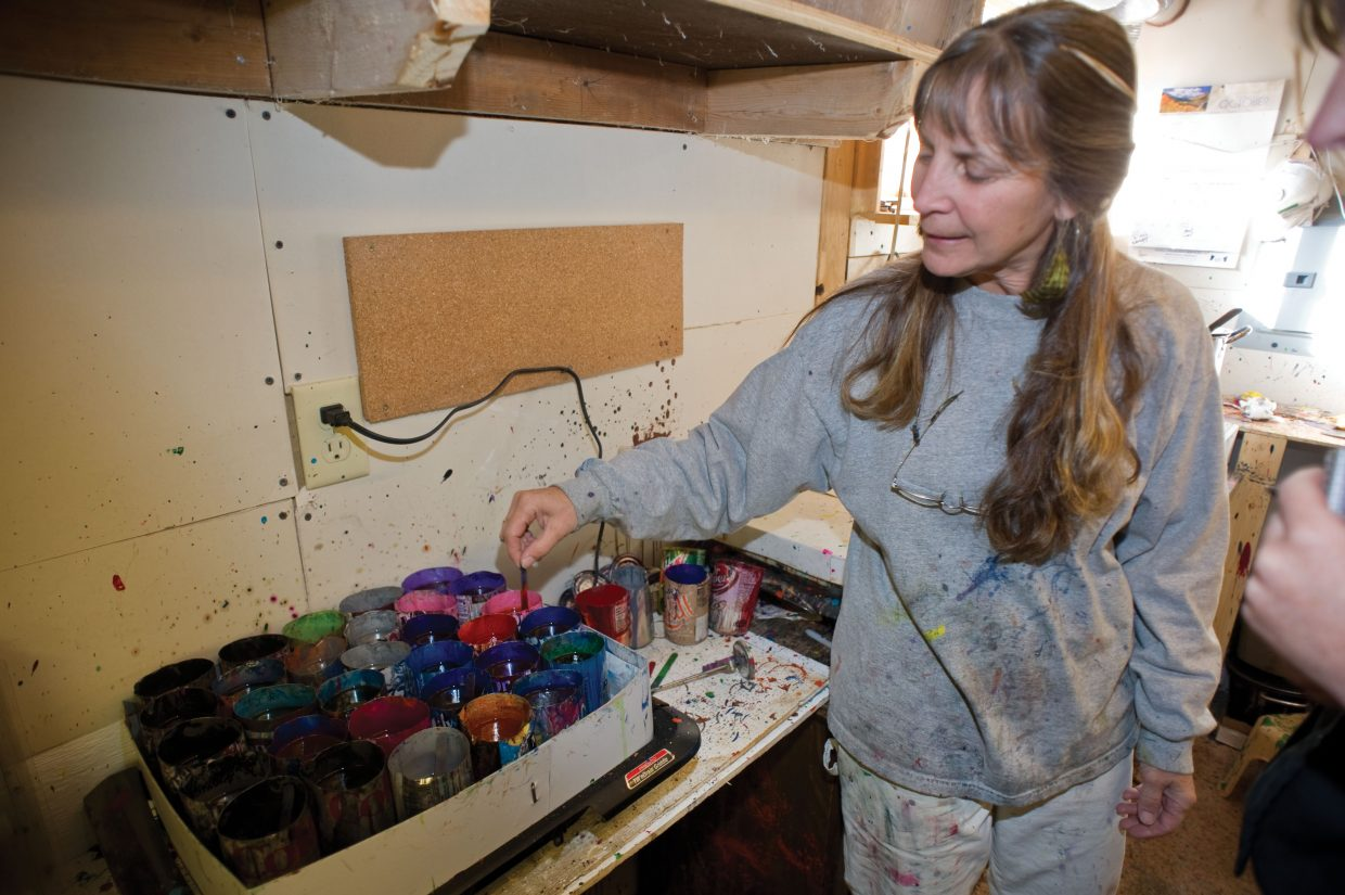 LuAnn Foty checks the color of melted crayons as part of the recycling process.