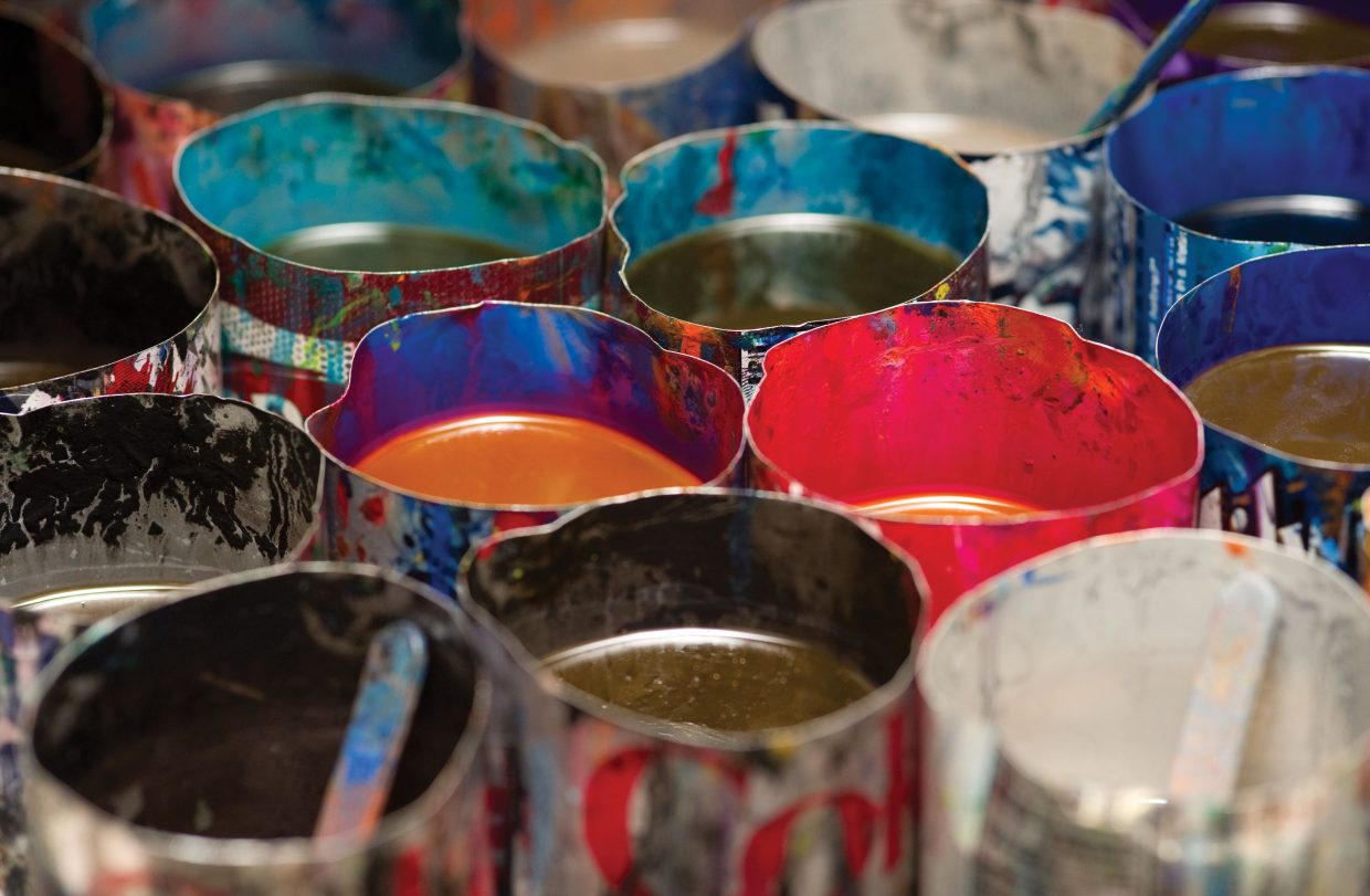 The bright colors of melted crayons are ready to be poured into molds.