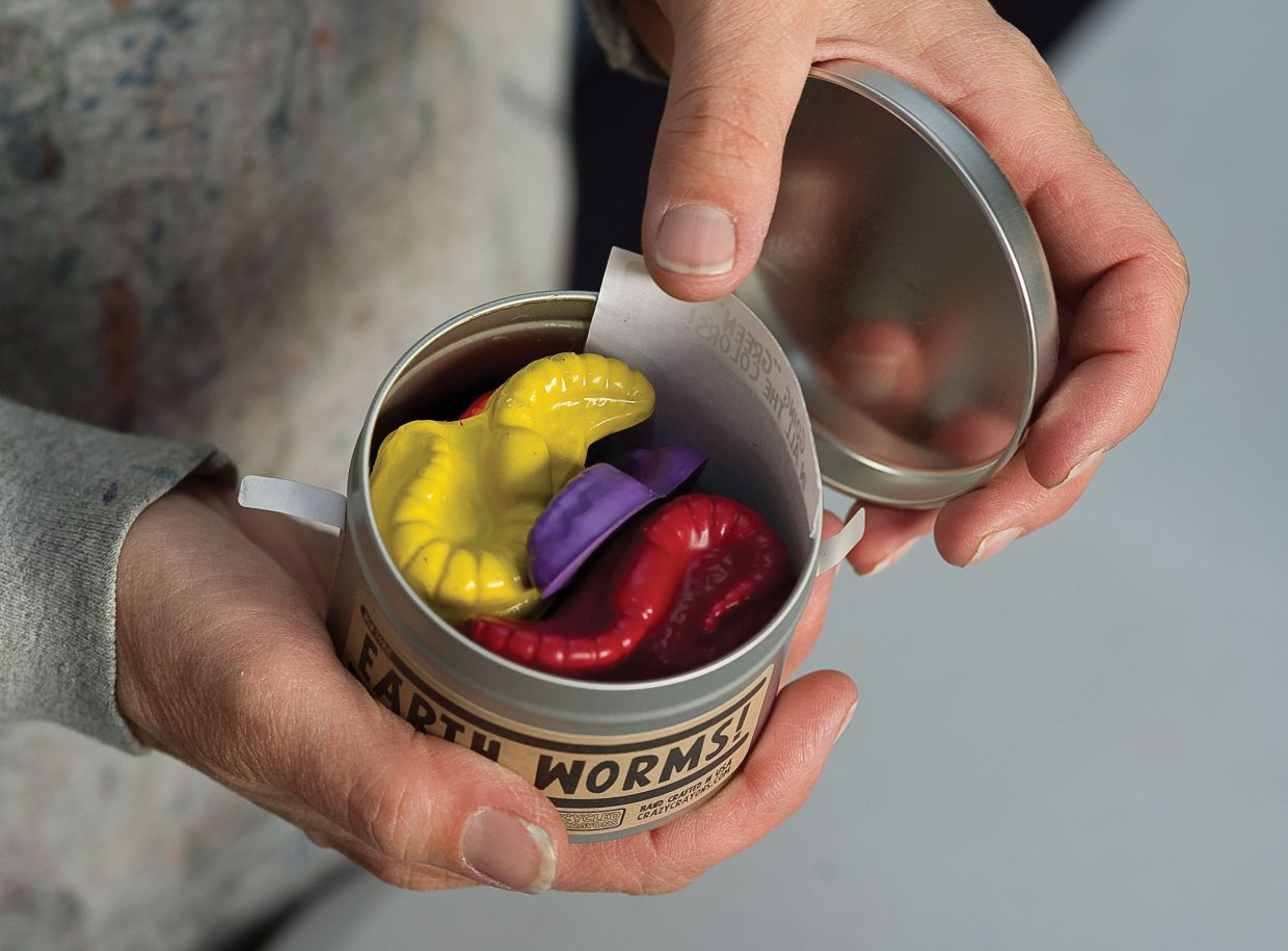 LuAnn Foty holds a tin of Earth Worms, a crayon she has molded and marketed to look like a can of worms.