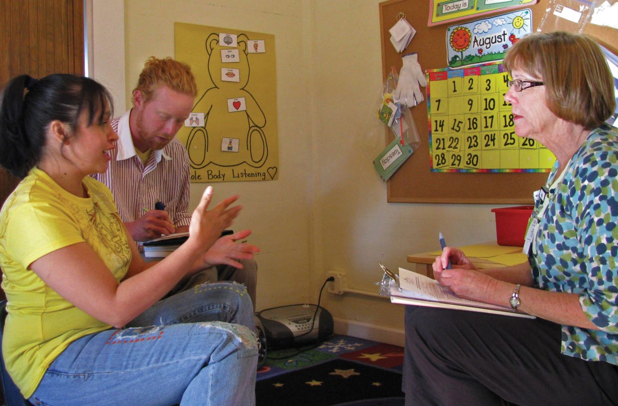 Judith Quintana, from left, interpreter Rodney Beall and speech-language pathologist Sally Hertzog meet at the Yampa Valley Medical Center SportsMed Pediatric Therapy Clinic.