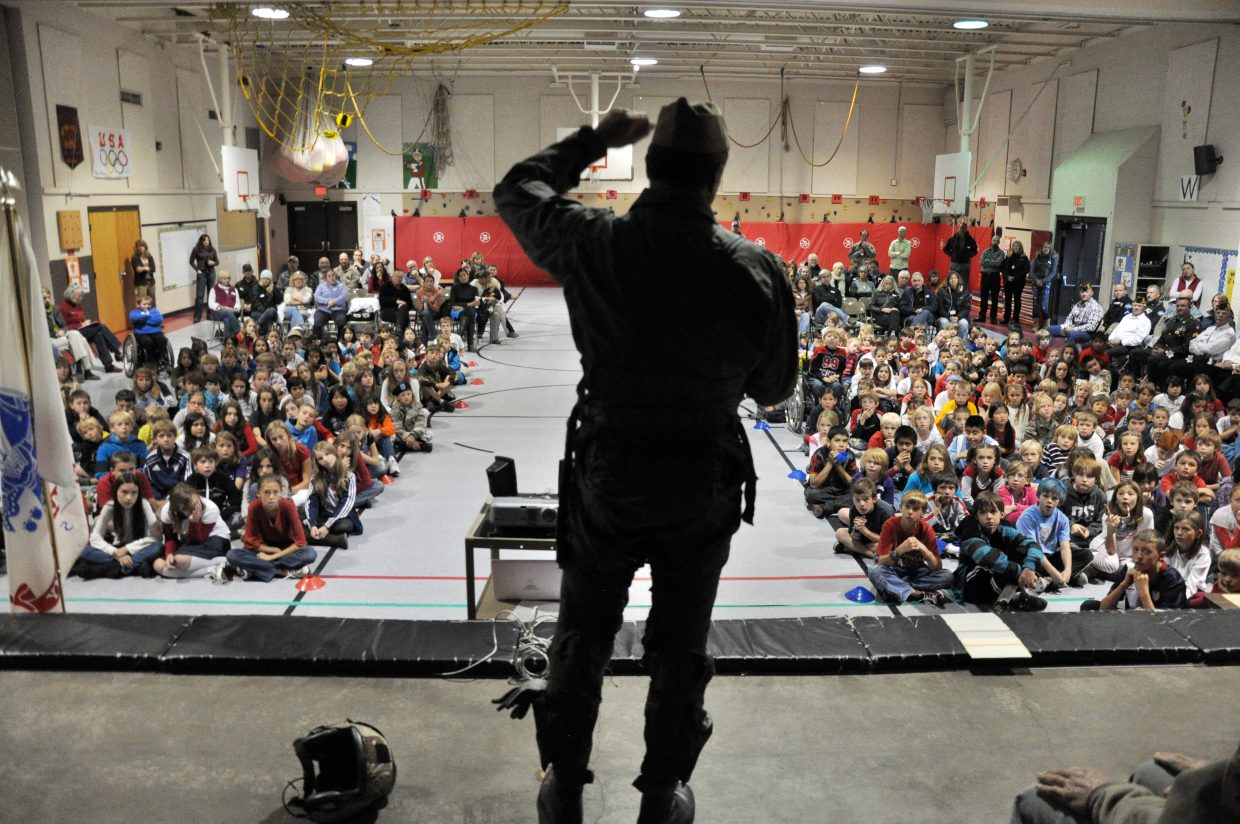 Veteran U.S. Navy pilot Scott Sanwick talks to Strawberry Park Elementary School students about his military service at an assembly marking the Veterans Day holiday in Steamboat Springs.