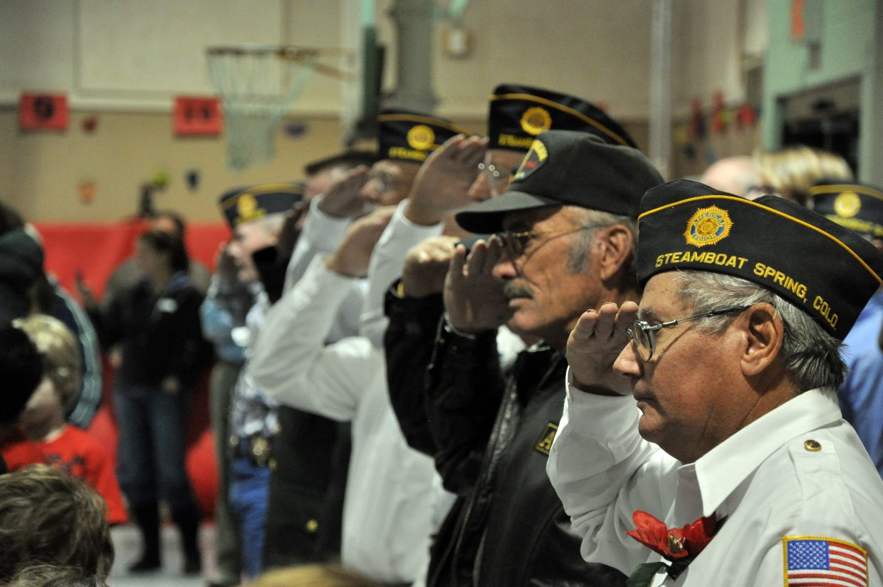 Steamboat Springs veteran Jim Stanko, front right, salutes Tuesday at a Strawberry Park Elementary School assembly marking the upcoming Veterans Day holiday.