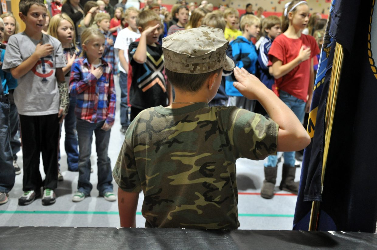 Strawberry Park Elementary School student Jack Roberts-McQuade salutes Tuesday at an assembly marking the upcoming Veterans Day holiday.