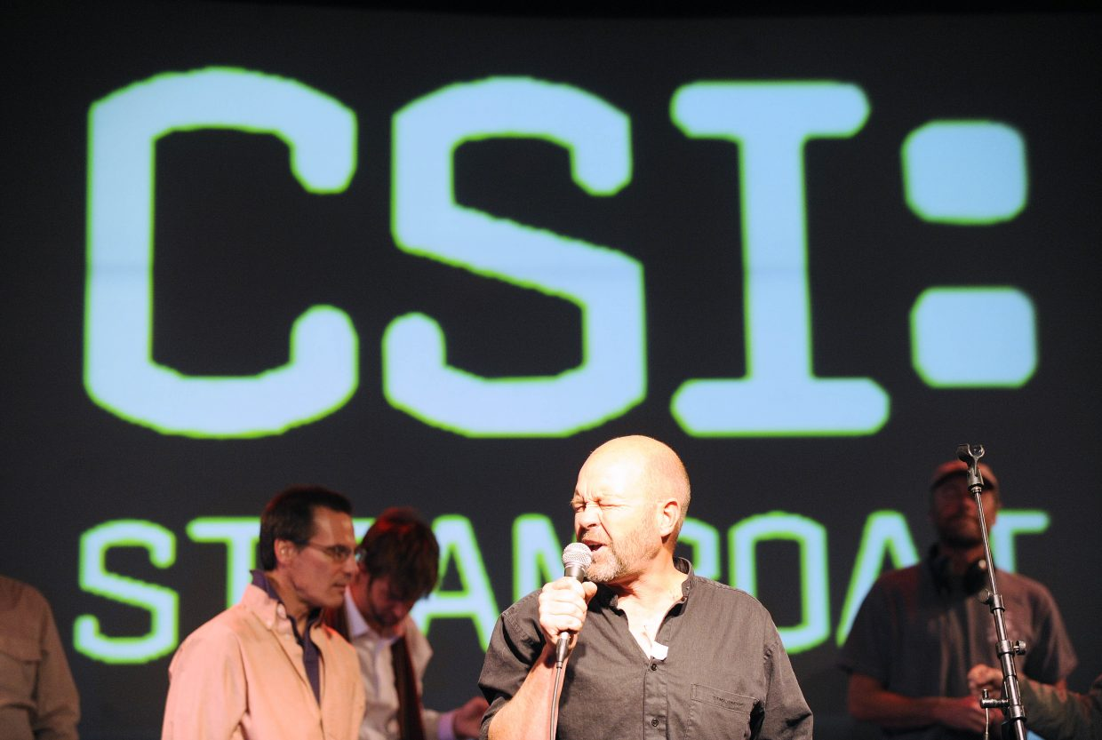 """Kris Hammond sings during a rehearsal of """"CSI: Steamboat — Who Killed the Economy?"""" rehearsal Tuesday night at The Steamboat Grand."""