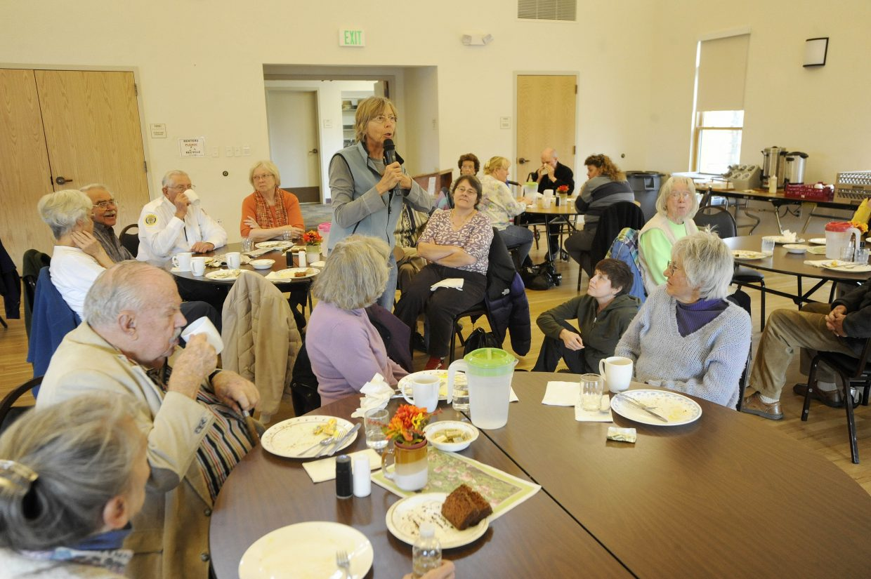 Seniors listen to South Routt County resident Molly McClure ask a question about prescription drugs during the Routt County Democrats' annual senior luncheon Tuesday at the Steamboat Springs Community Center. About 25 seniors were at the lunch, which was attended by Sen. Mark Udall, Rep. Jay Fetcher and Sen. Michael Bennet representative Todd Hagenbuch.