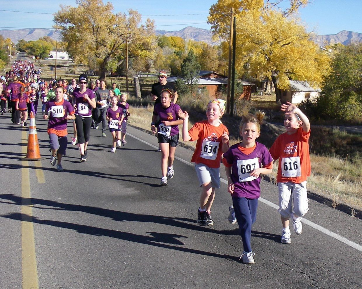 Alexa Paoli, 634, and Lauren Ehrlich, 616, participate in the Harbert Lumber Fall 5K.