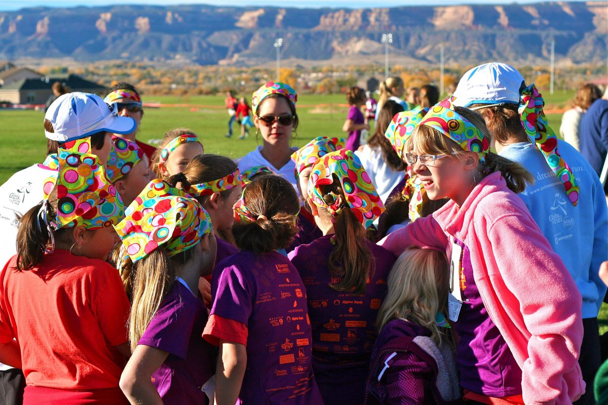 The Steamboat girls talk before the 11th annual Harbert Lumber Fall 5K on Saturday.