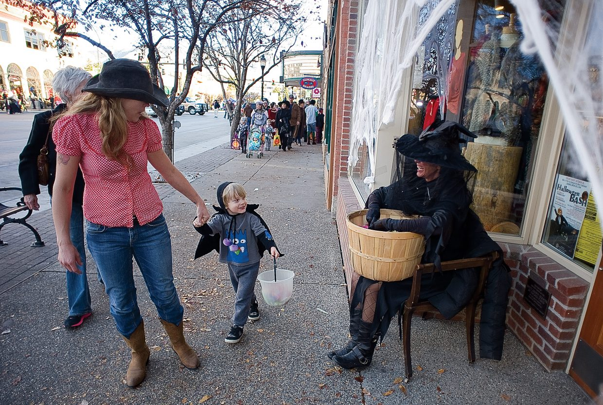 Doree Waters and Owen Waters thank Bette Vandahl, owner of Eighth Street West, after getting candy at the annual Downtown Halloween Stroll on Lincoln Avenue.