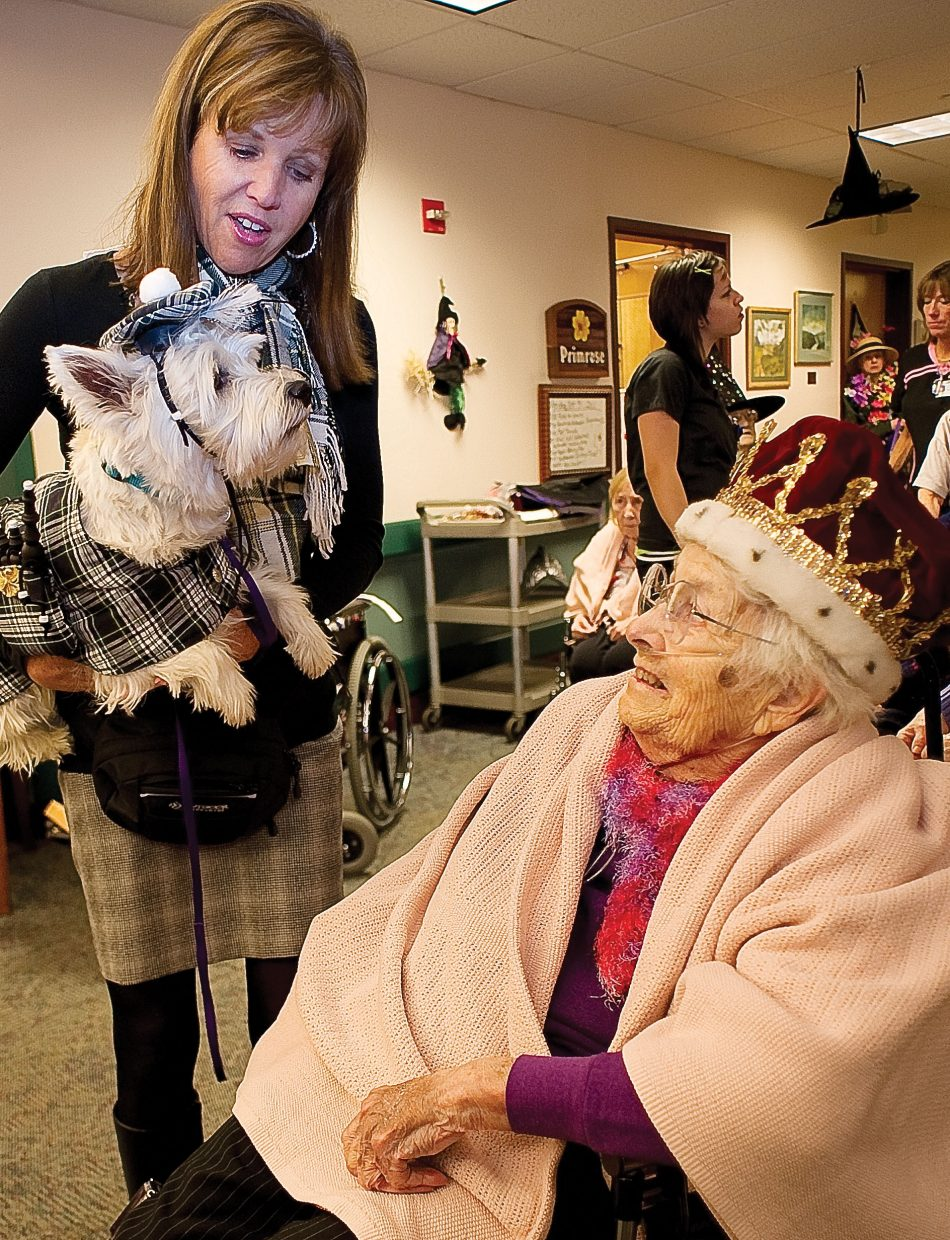 Neva Brown visits with William Wallace Braveheart, Willy for short, and owner Denise Brown at the Doak Walker Care Center on Monday morning. Brown was part of the Heeling Friends group that dressed up for Halloween and took a few minutes to visit residents.