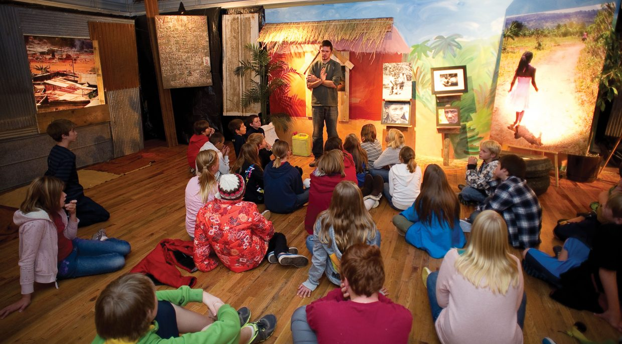 Cody Goings, of Come Let's Dance, visits with Steamboat Springs Middle School students Tuesday morning at the Depot Art Center.