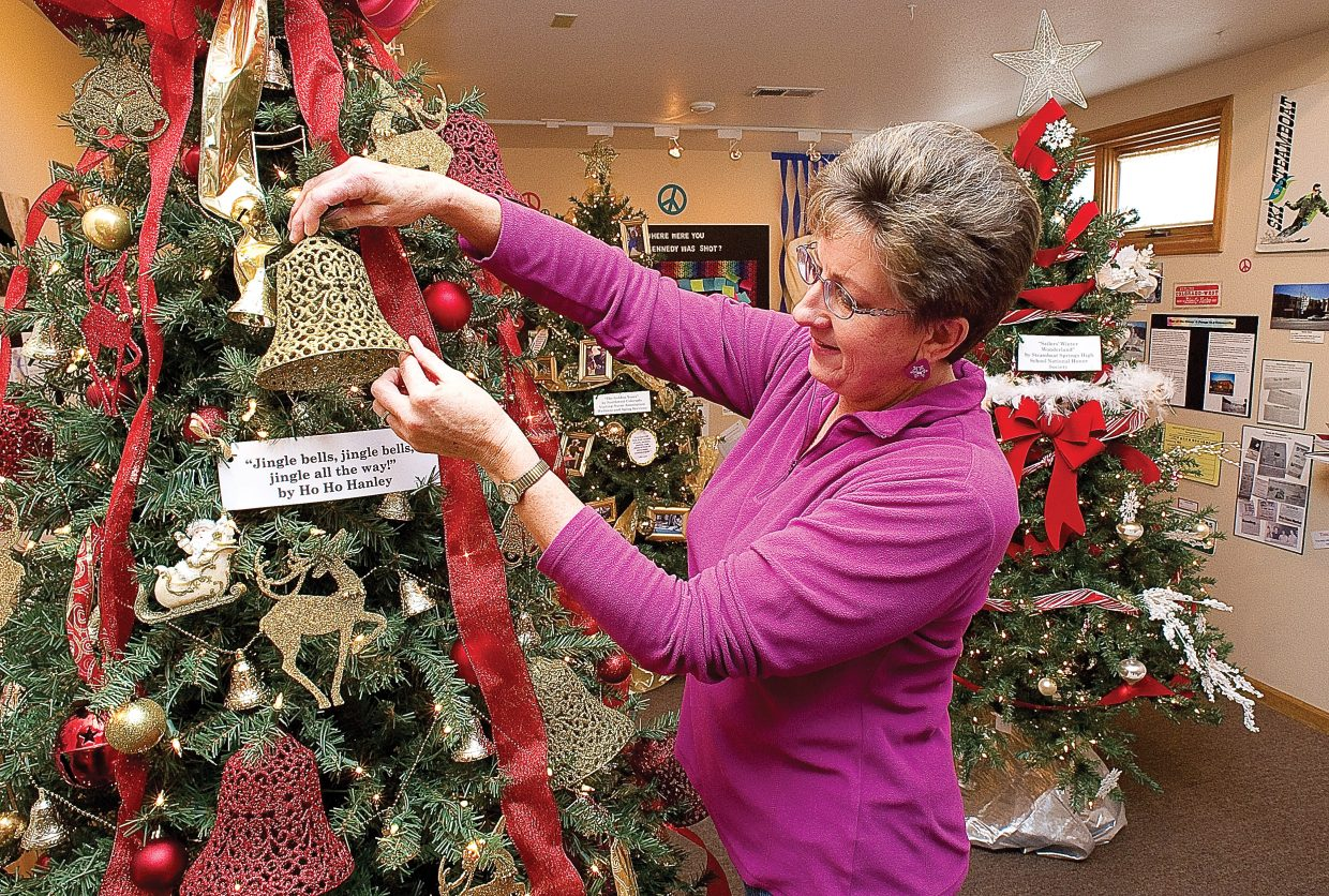 Gail Hanley spruces up her tree at the Tread of Pioneers Museum in downtown Steamboat Springs on Monday afternoon. The annual Festival of Trees display includes 14 decorated trees and is open daily from 11 a.m. to 5 p.m. through Monday.