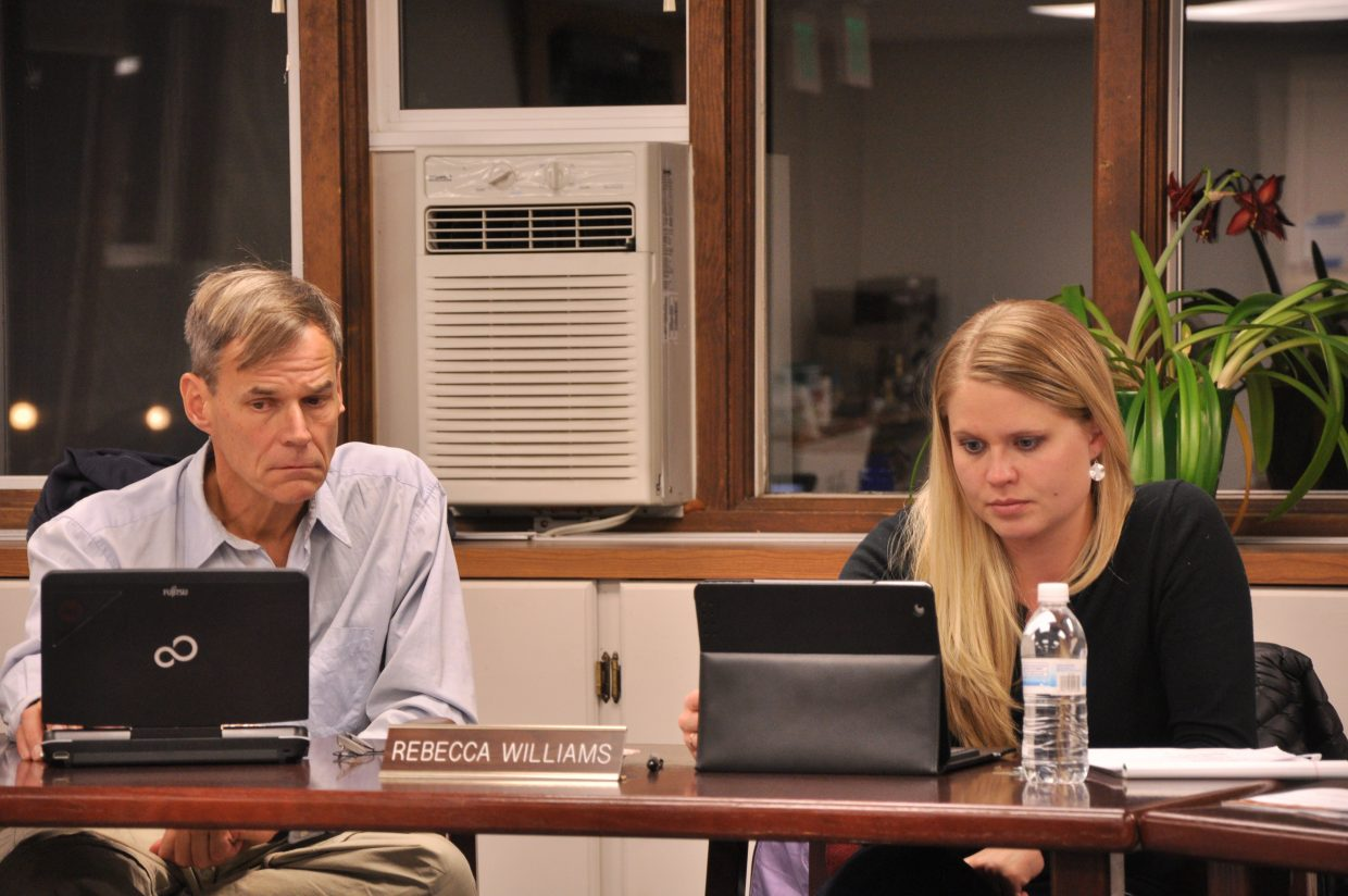 Steamboat Springs School Board members Wayne Lemley, left, and Rebecca Williams were sworn in at a board meeting Monday night with returning board member Robin Crossan.