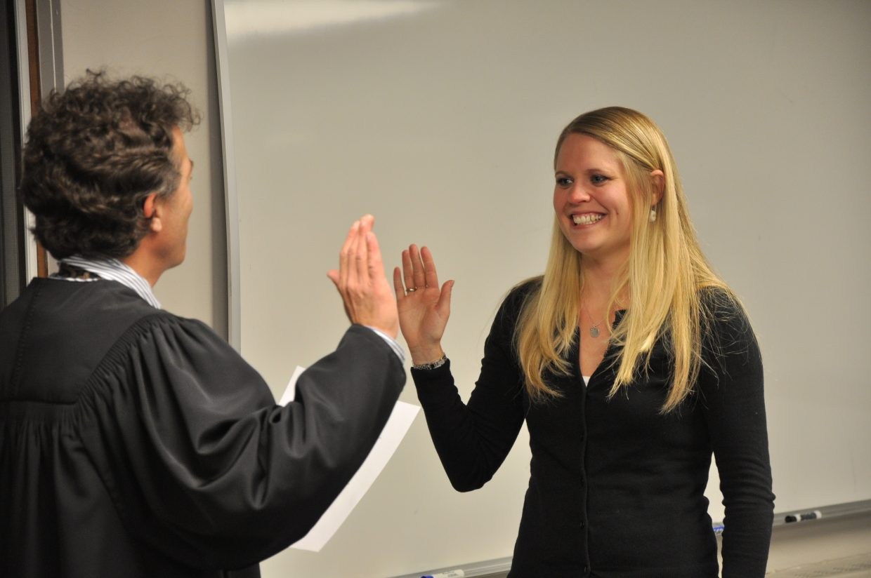 Attorney Paul Sachs swears in Steamboat Springs School Board member Rebecca Williams on Monday night at its meeting.