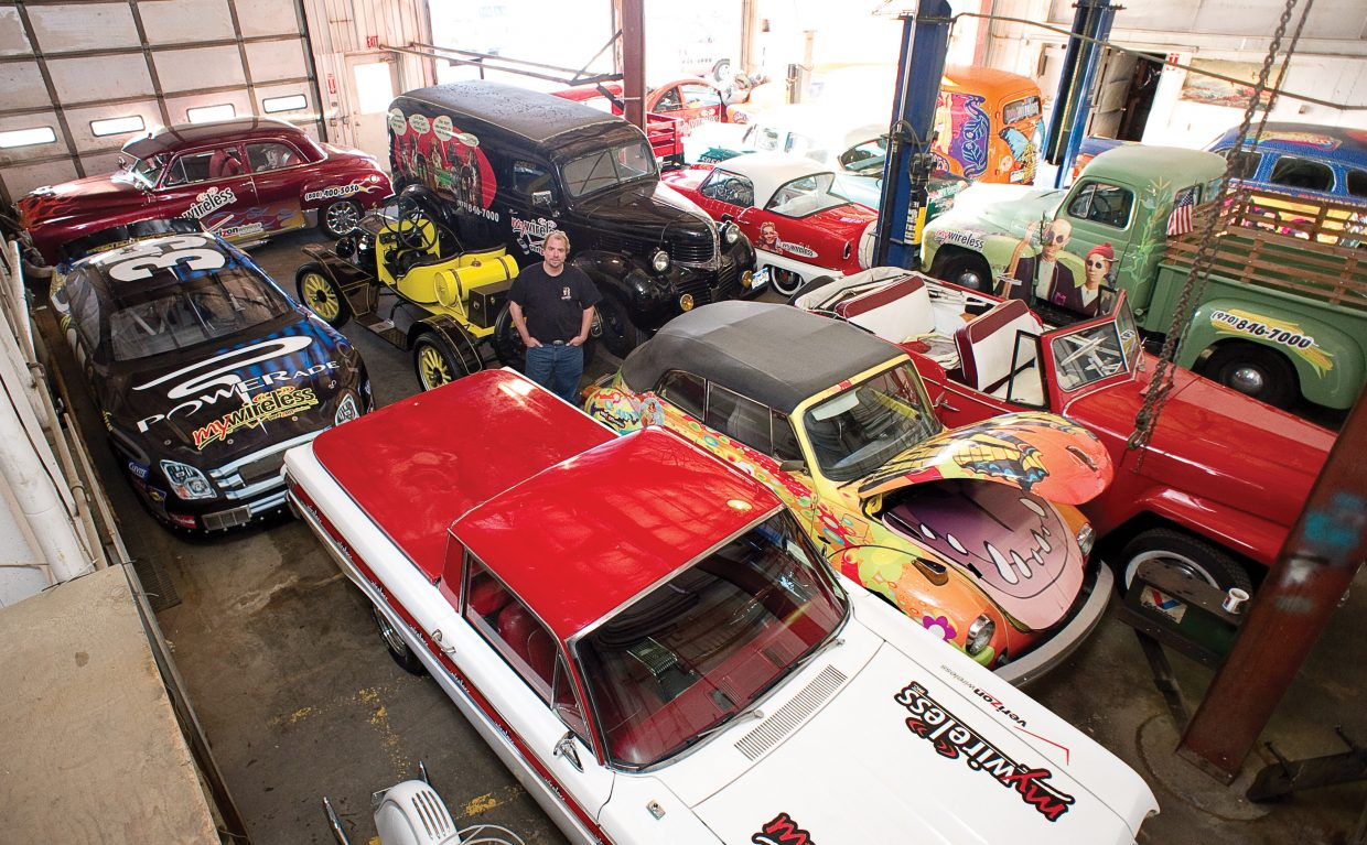 Andy Brown, CEO and founder of My Wireless, stands inside a Steamboat Springs warehouse used to store more than 50 classic cars and motorcycles used for marketing. The Steamboat Springs-based company recently was sold to Go Wireless, of Las Vegas, and Brown said he plans to sell the cars.