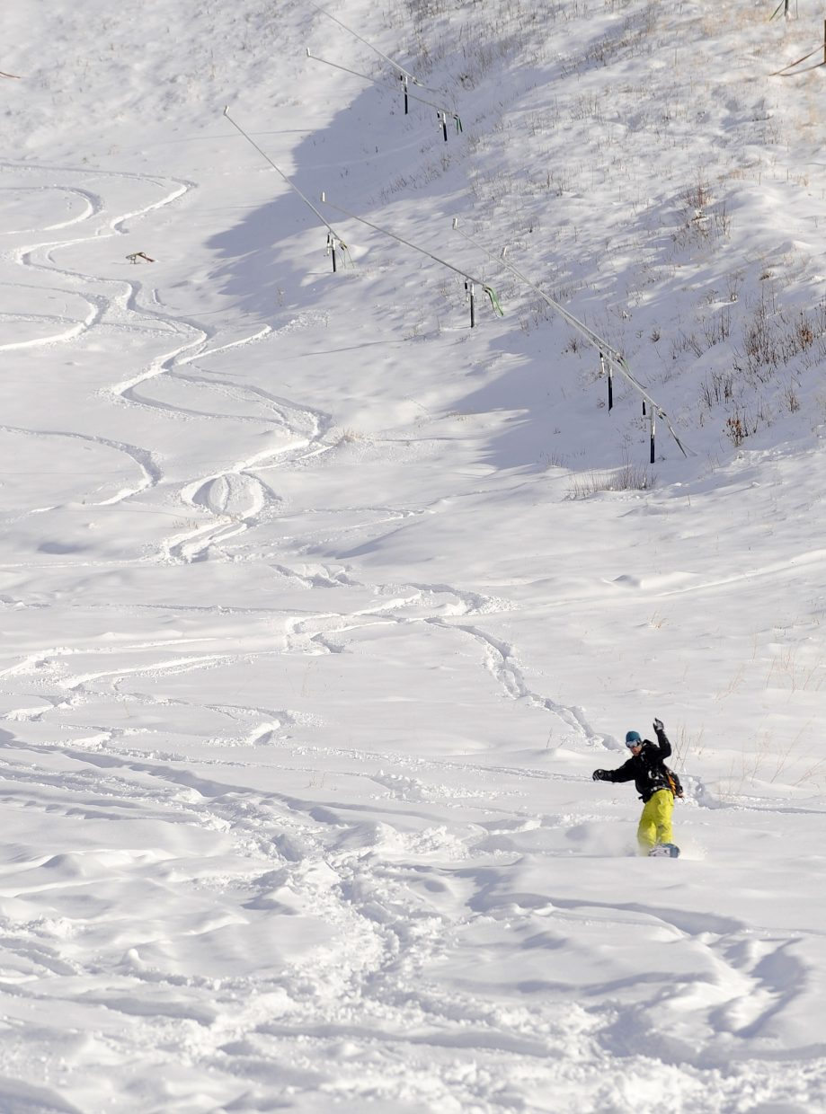 Steamboat Springs resident Kenny Loose rides down the See Me trail at the Steamboat Ski Area on Wednesday afternoon.