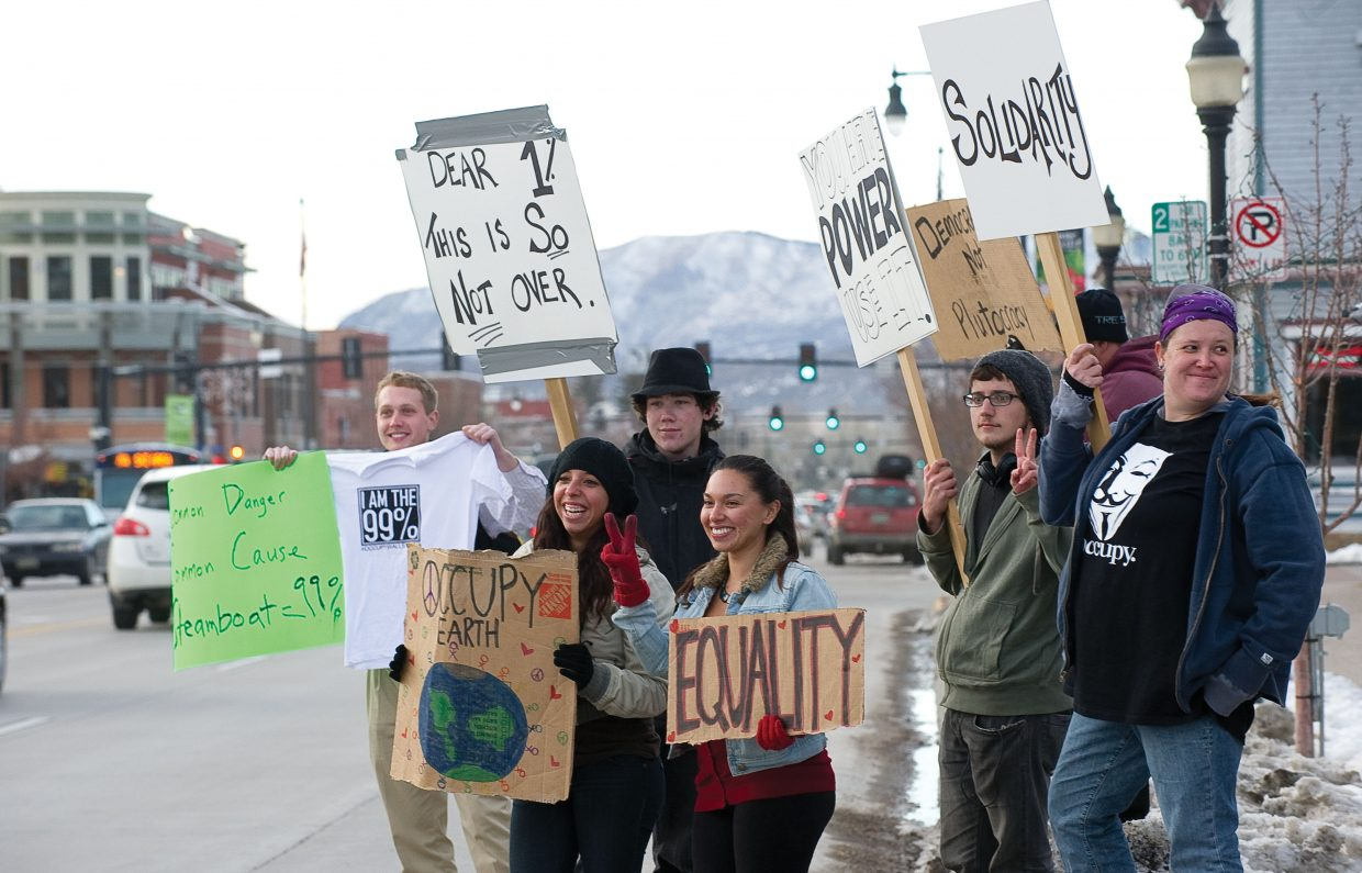 Protesters express their feelings with signs aimed at passing motorists during an Occupy Steamboat demonstration Thursday afternoon in front of the Routt County Courthouse. Local demonstrators came out to participate in the Occupy movement's day of action, protest the greed of the nation's wealthiest 1 percent and show their support for the movement, which started two months ago in New York City and since has spread across the country.