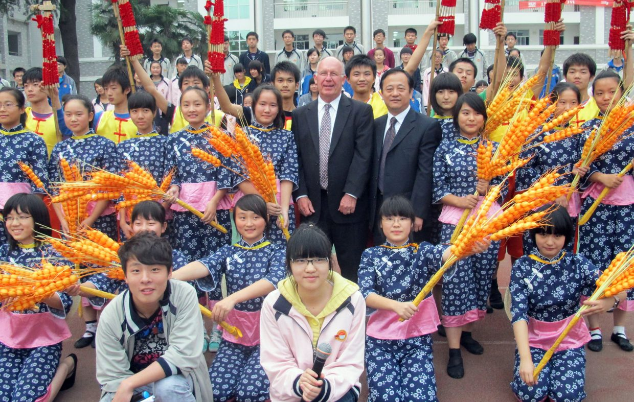 The Lowell Whiteman School Head of School Chris Taylor, center, stands with students Nov. 2 in Ma'an Shan China. Lowell Whiteman seniors will this spring visit China as part of the school's Global Immersion Studies program.