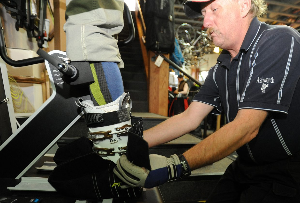 Steamboat Ski & Bike Kare's Bill Kipper fits a Fischer Vacuum boot to the foot of Diane Godfrey on Friday in Steamboat Springs. The boot's hard plastic shell is made so it can mold to a skier's foot.