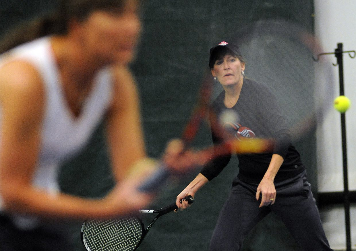 Marci Valicenti, right, prepares to hit a return Sunday in Steamboat Springs.