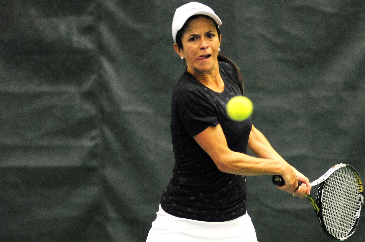 Fabiola Katthain swings for a return while playing Sunday during the City Tennis Championships in Steamboat Springs.