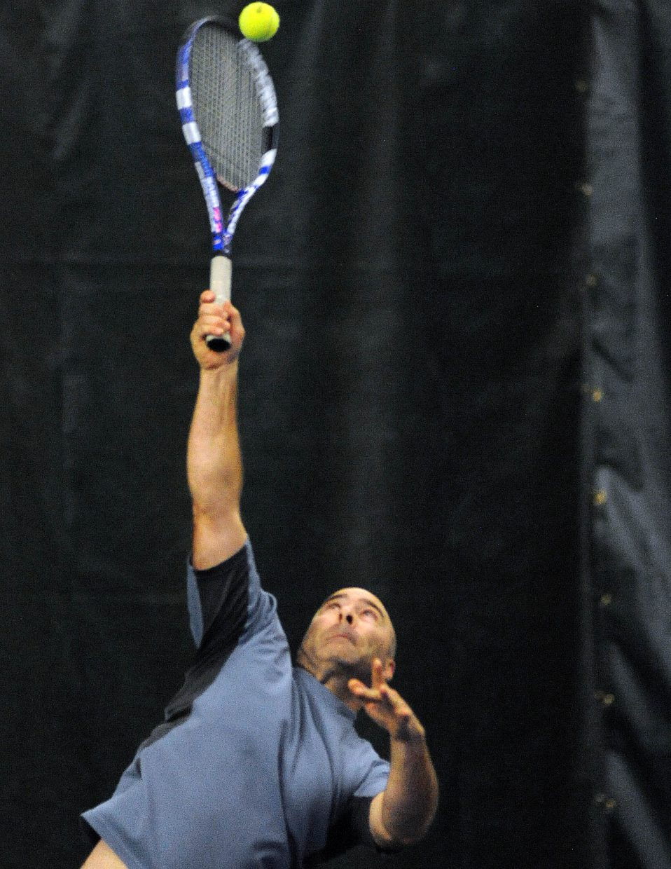 Scott Fox reaches to connect for a serve Sunday during the City Tennis Championships in Steamboat Springs.