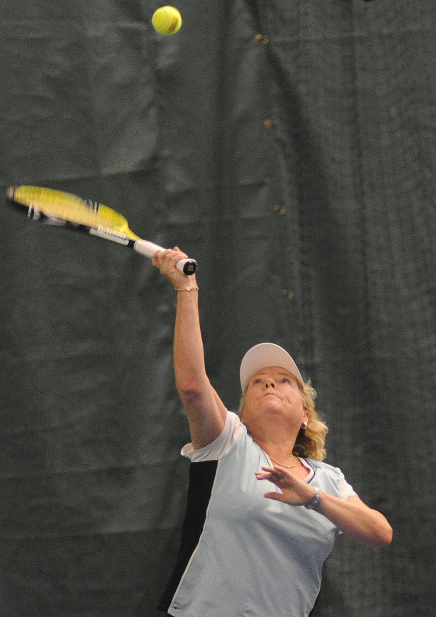 Susie Allen swings for a serve Sunday in Steamboat Springs.