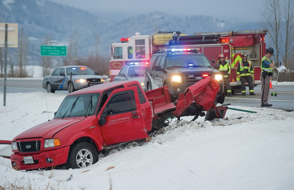 The Colorado State Patrol investigates a two-car accident on U.S. Highway 40 near the intersection of Colorado Highway 131 on Monday evening. A small pickup was heavily damaged after being struck by a semitrailer.