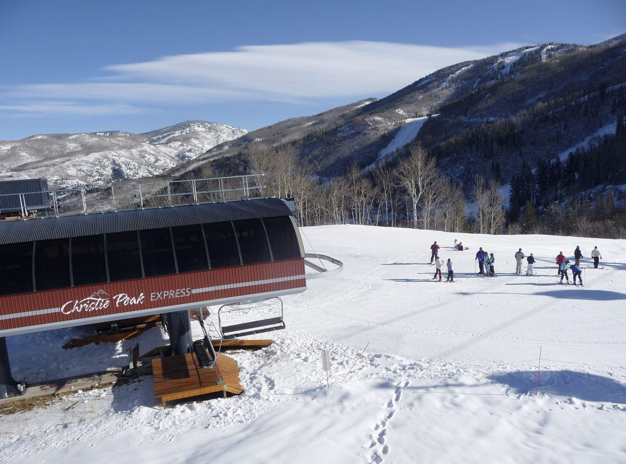 Skiers unload the Christie Peak Express chairlift on Wednesday morning during Scholarship Day at Steamboat Ski Area.