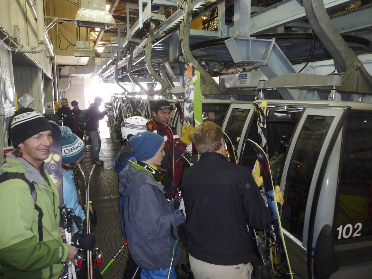Skiers load the gondola Wednesday morning during Scholarship Day at Steamboat Ski Area.
