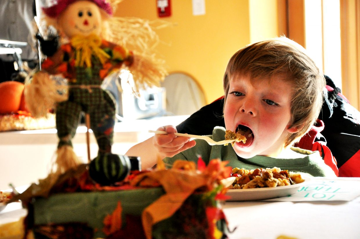 Joe Landon takes a bite of his dinner Thursday at the Routt County United Way Community Thanksgiving Dinner in Steamboat Springs.