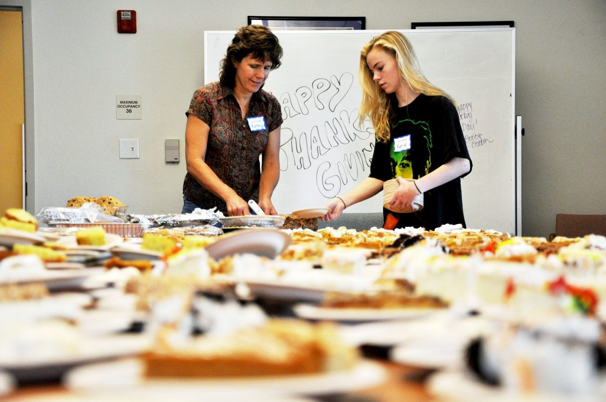 Kathy Gibbs, left, and Katie Stanhope prepare desserts for the Routt County United Way Community Thanksgiving Dinner. Organizers said the event served 934 plates at the holiday meal.