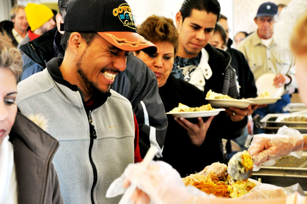 Alfredo Jimenez was all smiles as he had his plate topped off Thursday at the Routt County United Way Community Thanksgiving Dinner in Steamboat Springs.