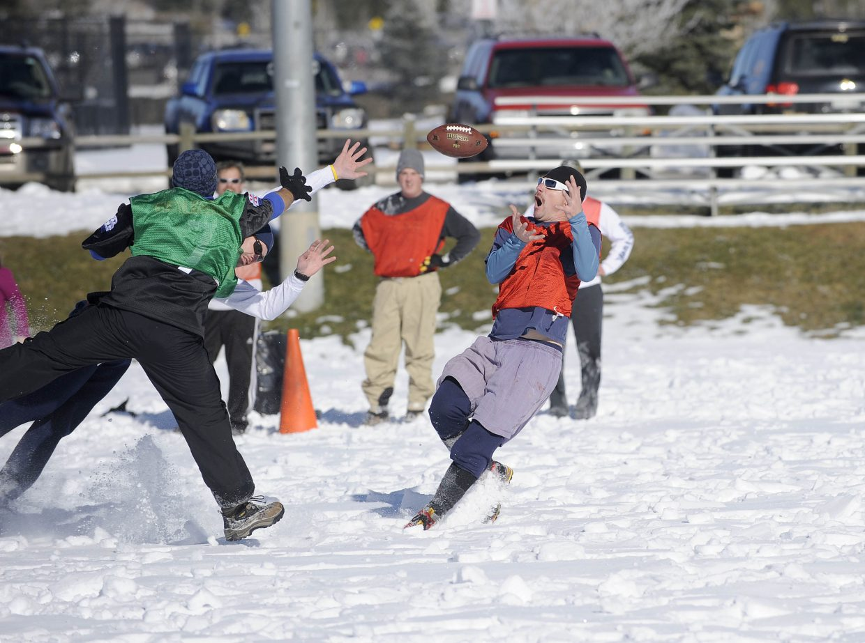 Kerry Shea brings in a pass during the Turkey Bowl on Thursday at Ski Town Fields.