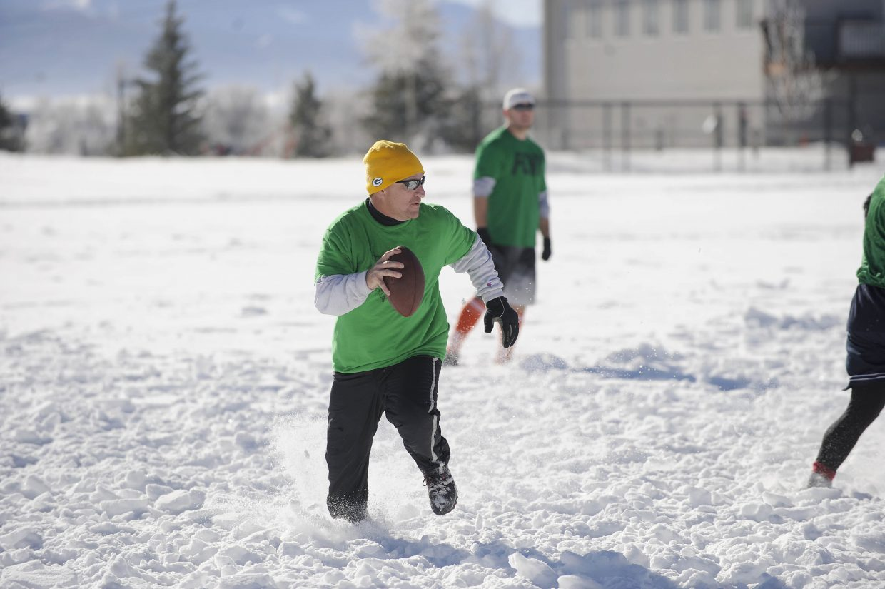 Jerry Stabile looks for an open teammate during the Turkey Bowl on Thursday at Ski Town Fields.