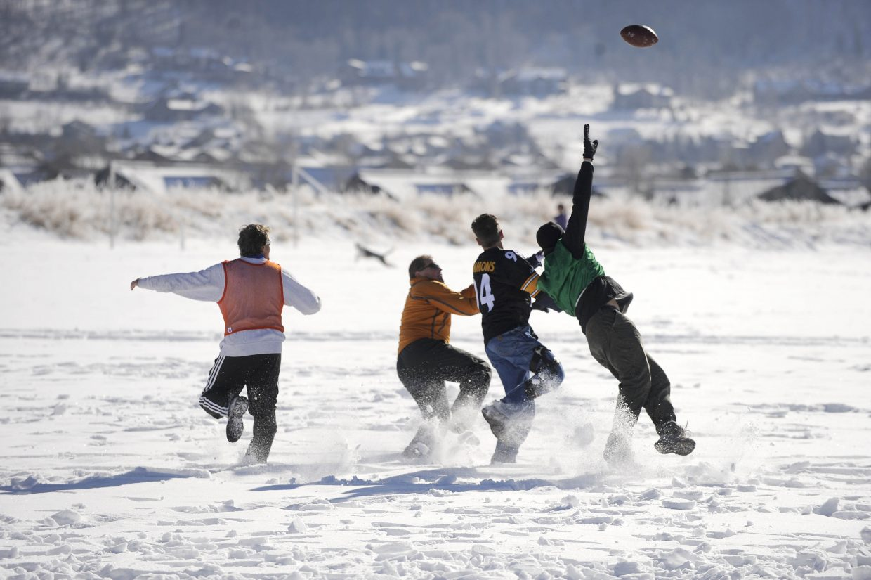 Turkey Bowl players go after a pass at Ski Town Fields.