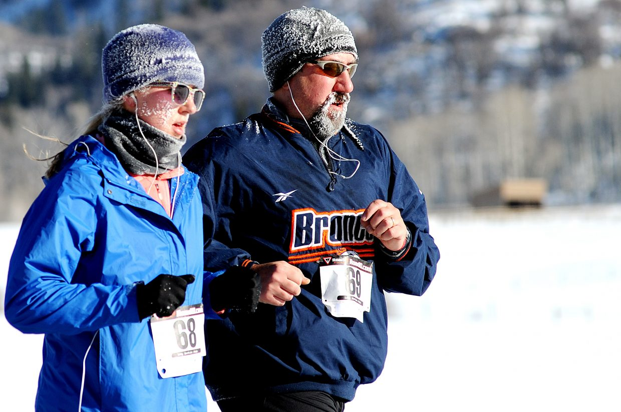 Erin Boettcher, left, and Tim Boettcher ice up as the run in Thursday's Turkey Trot race in Steamboat Springs. The event drew about 50 runners despite temperatures that dipped below 0.
