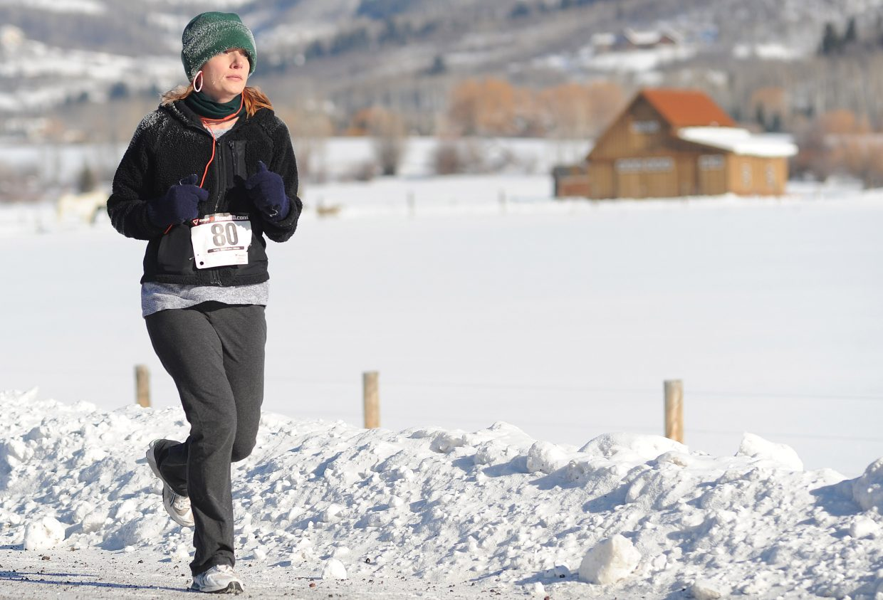 Lily Hanna runs in Thursday's Turkey Trot race in Steamboat Springs.