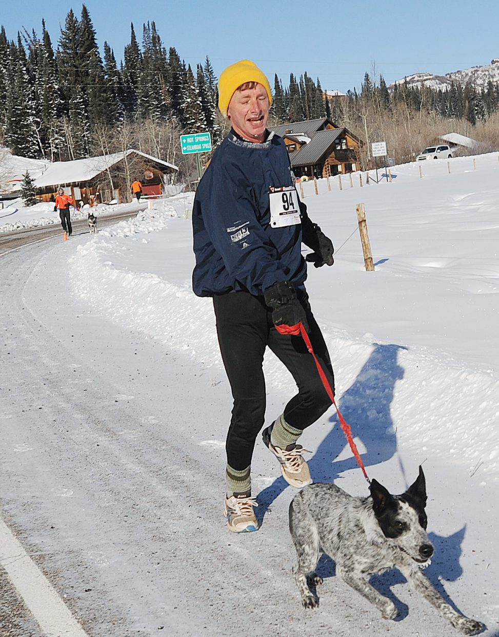 James Morton and his dog run Thursday in the Turkey Trot race in Steamboat Springs.