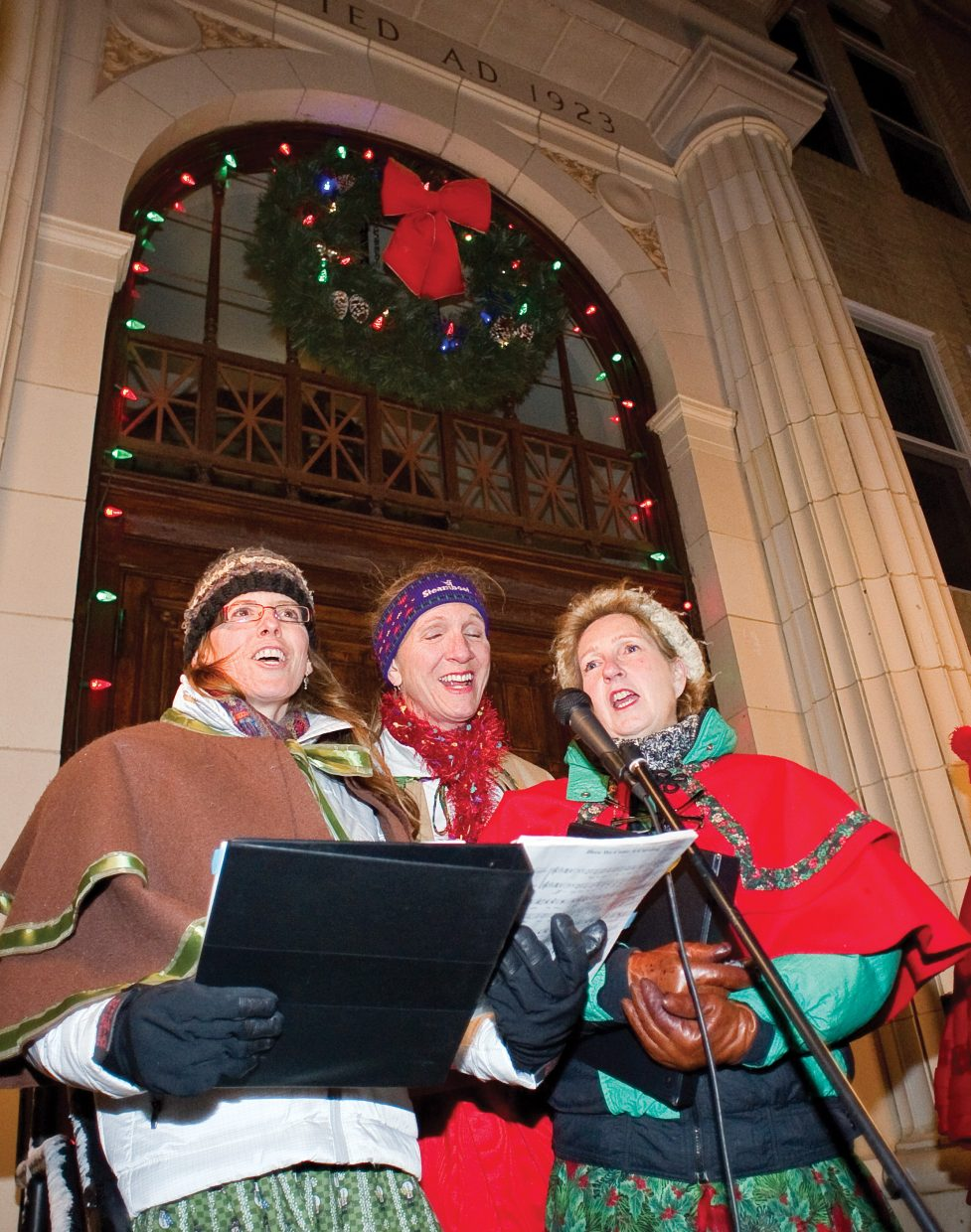 Chanel Caughey, Pam Pierce and Laura Frey perform Christmas carols Friday night on the Routt County Courthouse steps as part of the caroling group Bells of the Boat. The carolers were part of the seventh annual Light Up the Night community tree lighting ceremony. The night included the tree lighting, singing and even a visit from Santa Claus.