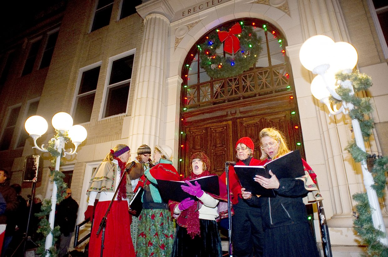 The Bells of the Boat caroling group performs on the steps of the Routt County Courthouse on Friday night as part of the seventh annual Light Up the Night community tree lighting ceremony.
