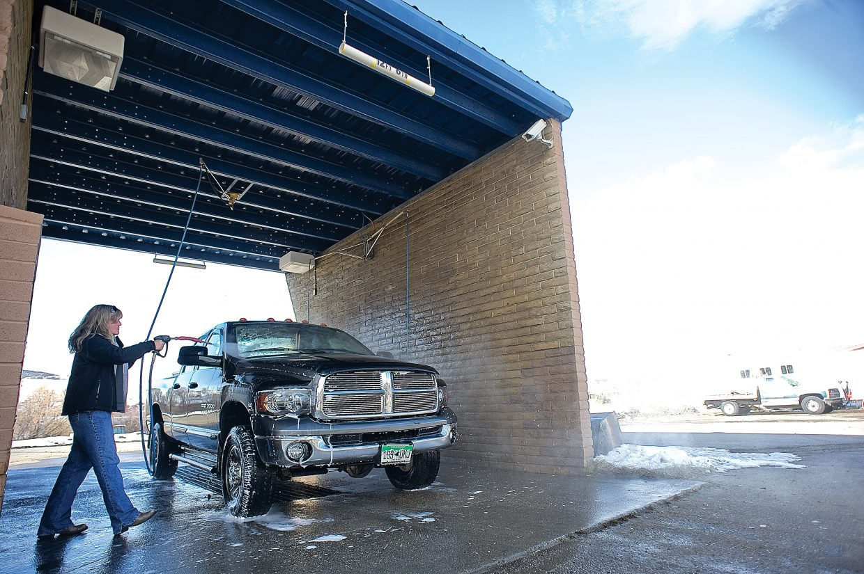Steamboat Springs resident Lisa Bankard takes advantage of Friday's mild weather to wash her truck at a local car wash. A fast-moving system passed through Steamboat late Friday, but the long-term forecast calls for more mild, sunny weather.